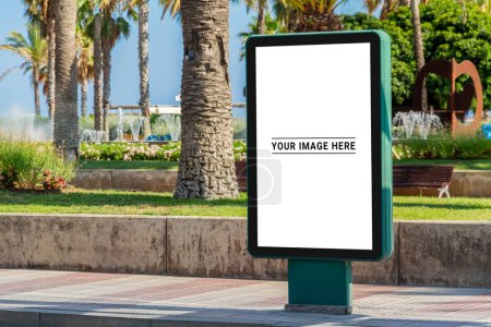 Outdoor billboard advertisement in seaside resort city with palms mockup