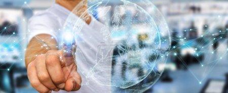 Photo pour Homme d'affaires sur fond flou à l'aide de rendu 3d terre interface réseau planète sphère - image libre de droit