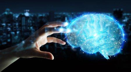 Photo pour Femme d'affaires sur fond flou à l'aide d'une projection 3d numérique d'un cerveau humain rendu 3d - image libre de droit