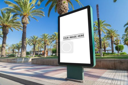 Photo for Outdoor billboard advertisement in seaside resort city with palms mockup - Royalty Free Image