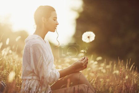 Photo for Free Happy Woman Enjoying Nature. Beauty Girl Outdoor. Freedom concept. Beauty Girl with dandelion, sunny flowers field. Sunbeams. Enjoyment and tenderness. Portrait photo - Royalty Free Image