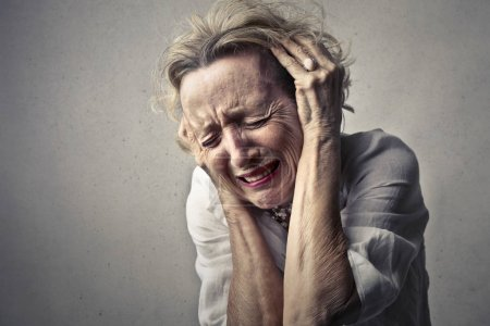 Senior woman having pain and feeling utterly sad.