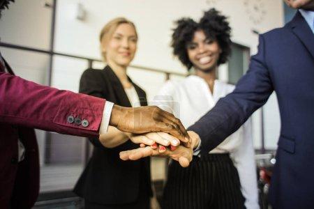 Multi ethnic business team sharing a team spirit.