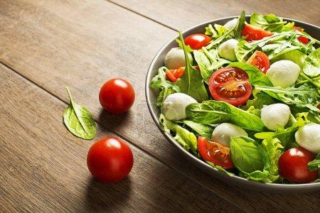Fresh salad with mozzarella cheese and tomato