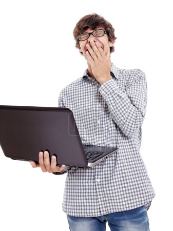 Young hispanic man wearing black glasses holding laptop in one hand, loudly laughing with closed eyes and with other hand near his face isolated on white background - humor and internet memes concept