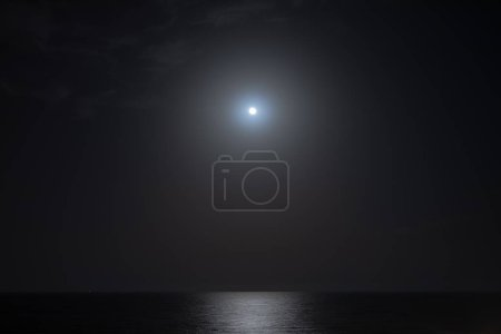 Photo for Full moon light with sea reflection at night - Royalty Free Image