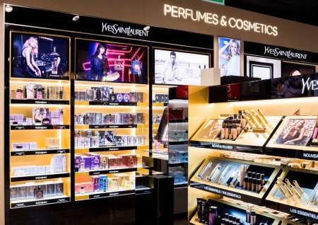 Photo for LONDON, UK - AUGUST 31, 2018: Yves Saint Laurent perfume and cosmetic makeup luxury collection in boutique store. Elegant shop. - Royalty Free Image