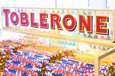 Photo for LONDON, UK - AUGUST 31, 2018: Tubes of Toblerone chocolate in grocery store with logo on display. Close up - Royalty Free Image