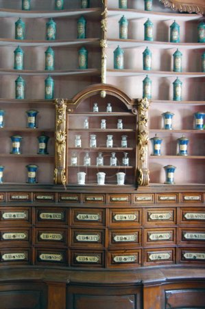 Hungary, Budapest - September 13, 2017: aged furniture in Fekete Sas Pharmacy Museum with boxes and bottles for herbs, powders and roots