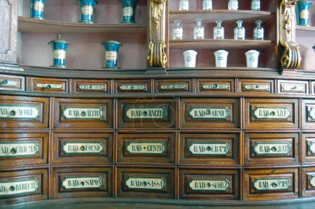 Hungary, Budapest - September 13, 2017: Aged furniture in ancient pharmacy with boxes and bottles for herbs, powders and roots in Fekete Sas Pharmacy Museum