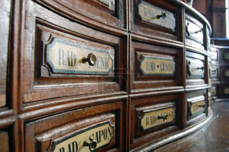 Hungary, Budapest - September 13, 2017: Close up of wooden boxes with different roots in Fekete Sas Pharmacy Museum