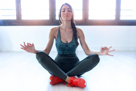 Photo for Shot of beautiful young woman doing yoga and relaxing at home. - Royalty Free Image