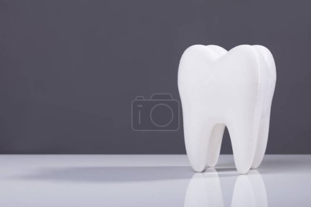 Oral Dental Healthy White Tooth On Grey Backdrop