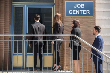 Group Of Businesspeople Standing In A Row Outside Job Center