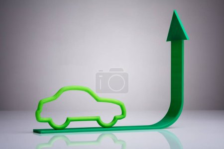 Blue Car Driving On Green Upward Arrow Against Gray Background