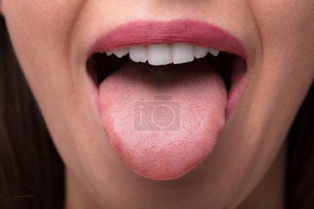 Close-up Photo Of A Woman Showing Tongue