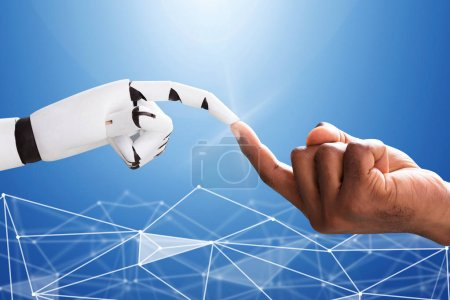 Robot Touching Man's Index Finger Against Digital Backdrop