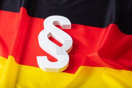Elevated View Of Paragraph Symbol On German Flag