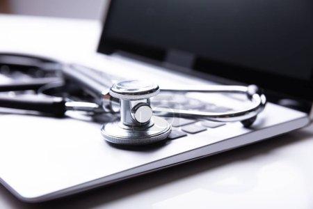 Close-up Photo Of Stethoscope On Laptop Keypad