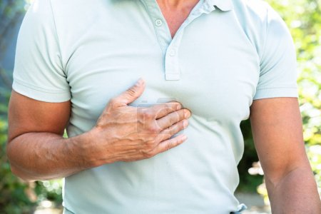 Midsection View Of A Man Having Acid Reflux Pain
