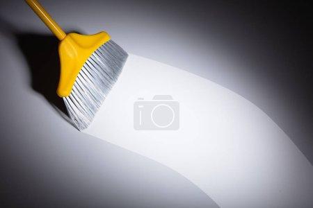 Elevated View Of Broom Sweeping Dust On Floor