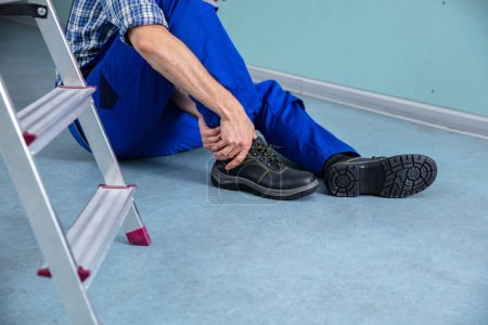Handyman Touching His Injured Leg After Falling From Ladder