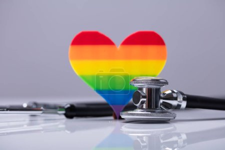 Close-up Of Rainbow Heart And Stethoscope On Reflective Background
