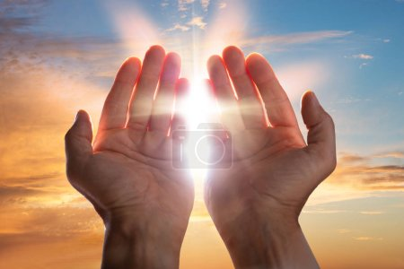 Photo for Close-up Of A Praying Hands With Sunlight - Royalty Free Image