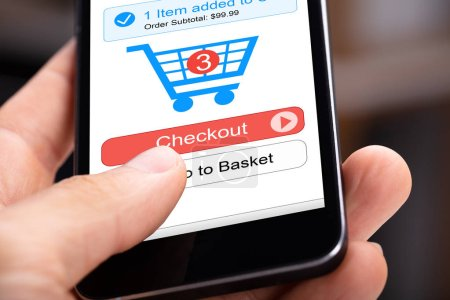 Human Hand Holding Mobile Phone With Online Shopping Application