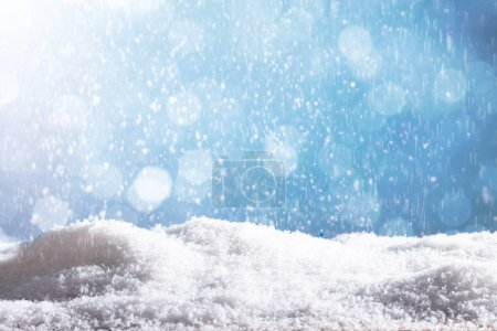 Close-up Of Snow Particles Falling Down Over A Blue Background
