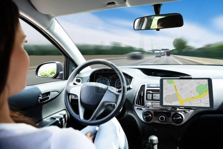 Close-up Of A Woman Traveling By Self Driving Modern Car