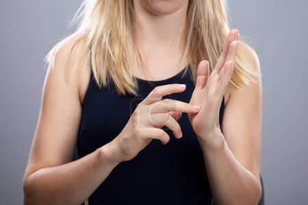 Close-up Of A Woman's Hands Using Sign Language