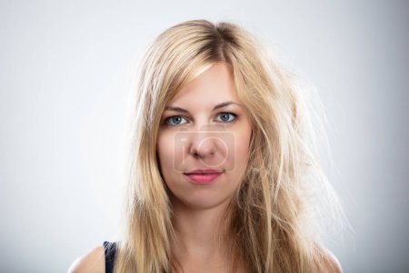Portrait Of A Woman With Blonde Hair Before And After Hair Straightening