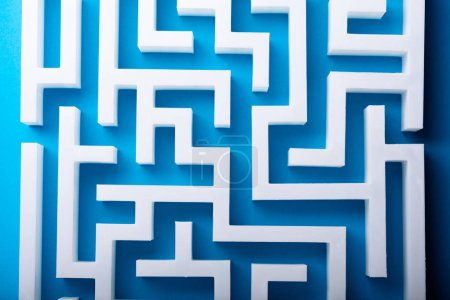 High Angle View Of White Maze On Blue Background