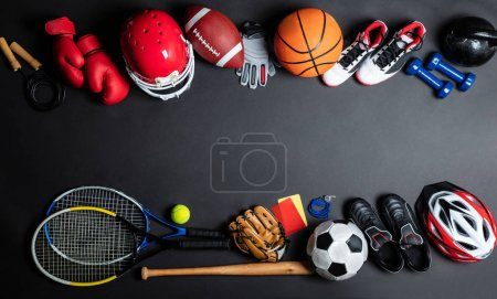 Photo for High Angle View Of Various Sport Equipment On Black Background - Royalty Free Image
