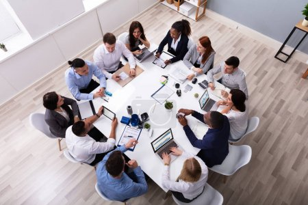 Group Of Multi Ethnic Business Team Sitting Together At Workplace In Modern Office