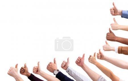Photo pour Gros plan de la main du peuple montrant pouce vers le haut signe contre isolé sur fond blanc - image libre de droit