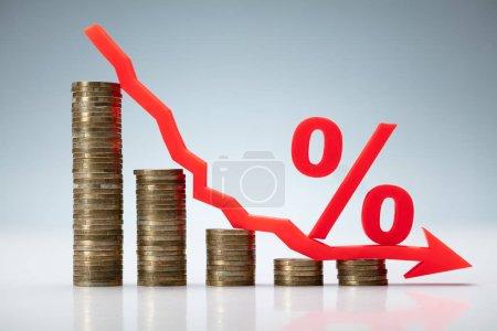 Photo pour Interest Rate Decreasing Graph Made Of Stacked Coins - image libre de droit