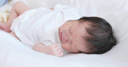New born baby sleep on bed