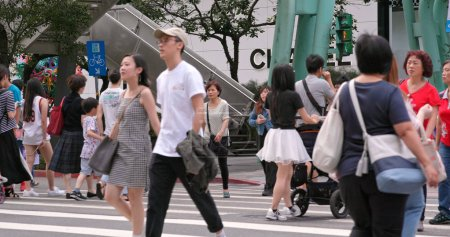Xinyi District, Taiwan - 30 May, 2018: People crossing the road in Taipei city