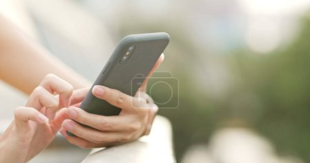 Close up of woman using mobile phone in the evening