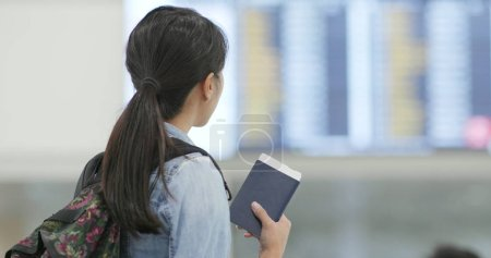 Travel woman holding passport in the airport