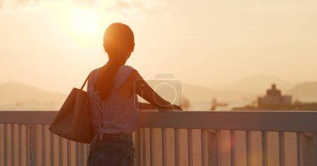 Asian woman enjoy the sunset