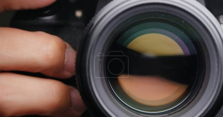 Photo for Close up of person  Changing Camera lens aperture - Royalty Free Image