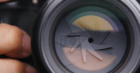 Photo for Close up of person  Adjusting Camera lens aperture - Royalty Free Image