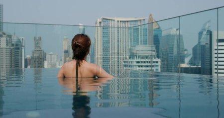 Photo for Woman enjoy at swimming pool - Royalty Free Image