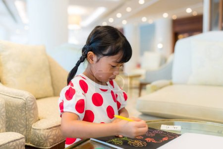 Photo for Little girl draw on book - Royalty Free Image