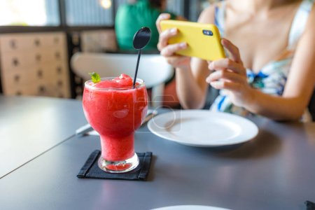 Photo for Woman take photo of the drink in restaurant - Royalty Free Image