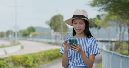 Photo for Woman search on cellphone of the location in city - Royalty Free Image