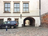 Passage yard and cobblestone pavement in old Riga(horizontally).